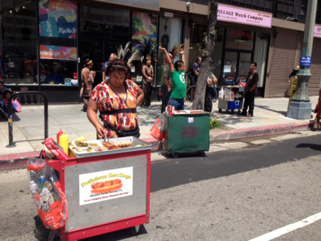 A street vendor prepares bacon-wrapped hot dogs in downtown Los Angeles, May 2013.