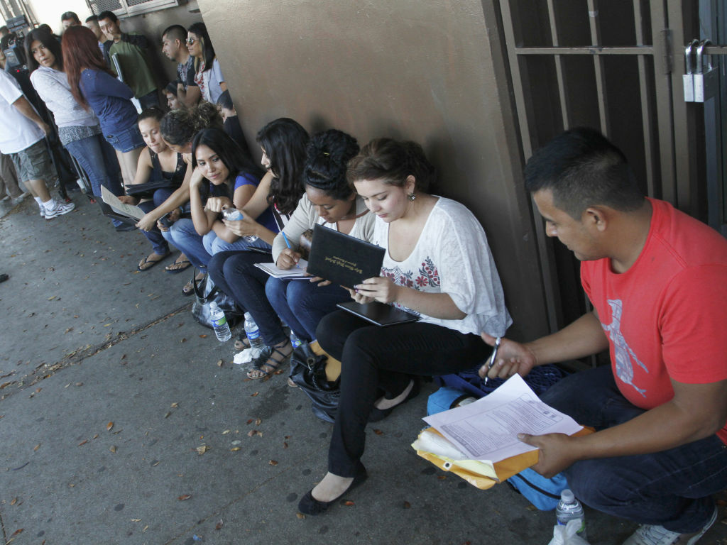 A crowd of people applying for the Deferred Action for Childhood Arrivals program last year