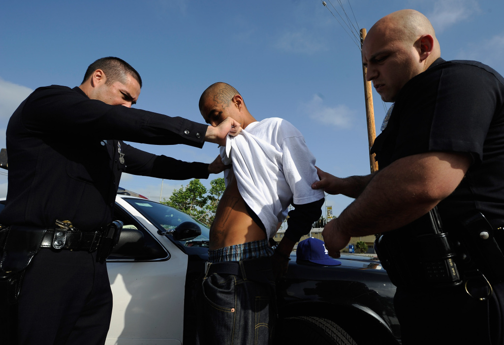 FILE: Los Angeles Police Department officers from the 77th Street Division detain a 21-year-old