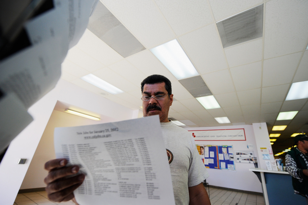 George Hernandez looks at job openings at the Foothill Employment and Training Connection in Pasadena earlier this year. Nearly $10 million in federal economic grants awarded Friday to Southern California cities and organizations are intended to keep or add new jobs.