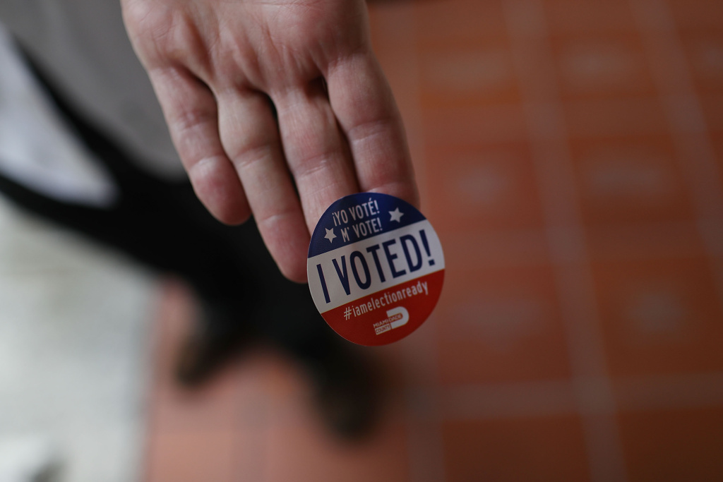 A voter shows off his, 'I Voted!', sticker. The current number of registered California voters is the second-highest in the state's history.