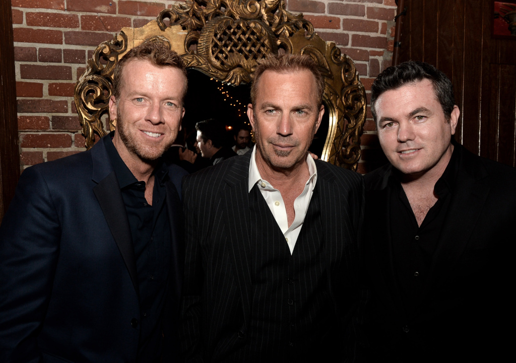 Director McG, actor Kevin Costner and executive producer Tucker Tooley pose at the after party for the premiere of Relativity Media's