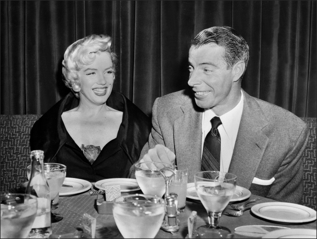 Picture dated of the fifties showing American actress Marilyn Monroe (L) with her husband baseball legend Joe DiMaggio.