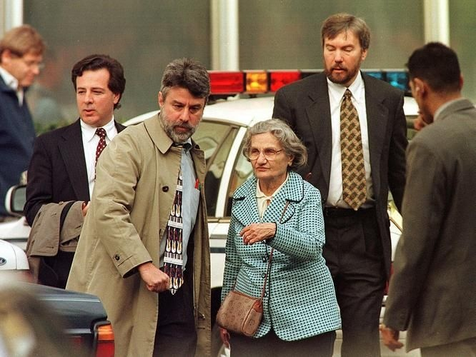 Wanda Kaczynski, center, and her son David Kaczynski, right background, are escorted to their car by defense lawyers after the suspected Unabomber Theodore Kaczynski pleaded guilty Jan. 22, 1998, in Sacramento, Calif.