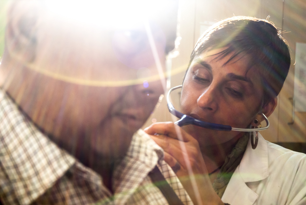 Simmi Gandhi, a nurse practitioner at the UMMA Clinic in South Los Angeles, uses a stethoscope to examine Hamdi Badar during a patient visit on March 12. This clinic and others like it are relying more on the skills of its nursing staff as the growing number of patients strains the ratio between caregivers and those in need of medical attention.