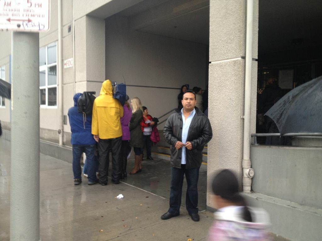 Oscar Esquivel waits for a meeting outside George De La Torre Jr. Elementary, where his daughter is in kindergarten