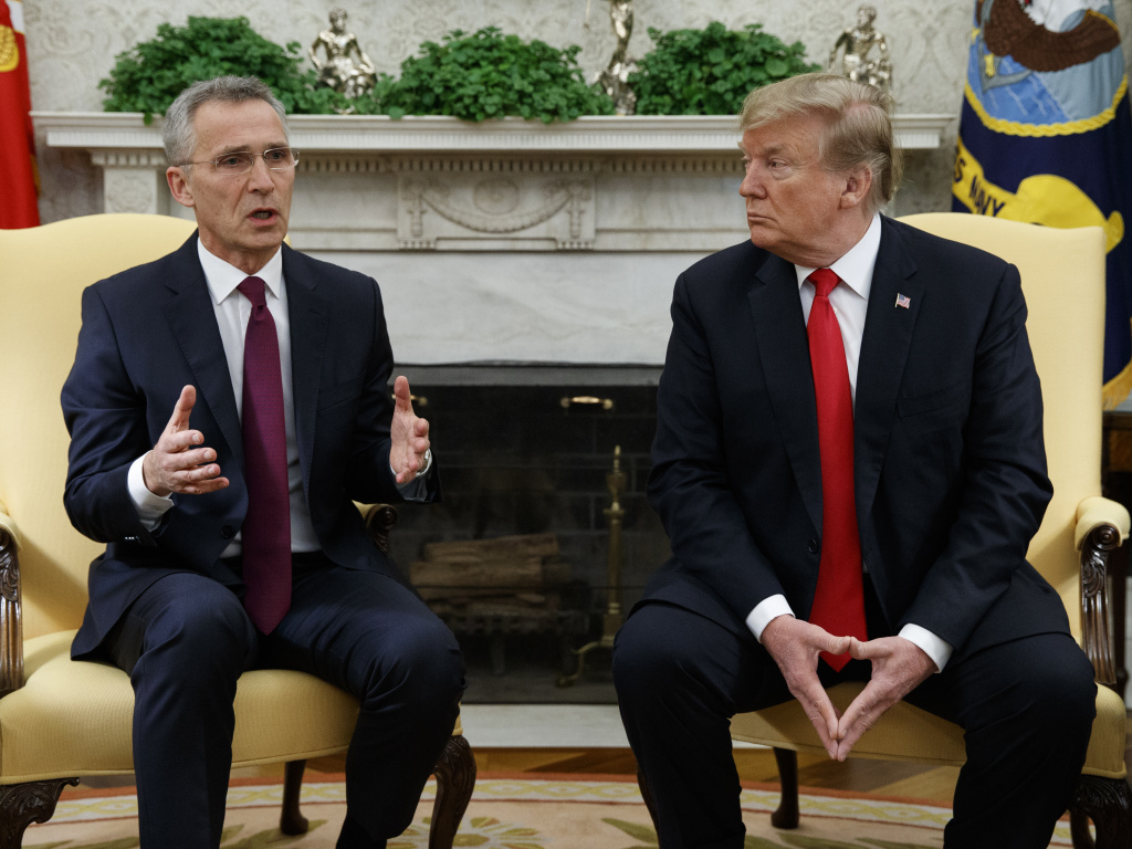 President Donald Trump listens as NATO Secretary General Jens Stoltenberg speaks during a meeting in the Oval Office of the White House, on Tuesday.