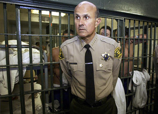 Los Angeles County Sheriff Lee Baca inside the Men's Central Jail at the Twin Towers Correctional Facility some years ago. During a session with reporters today he said he accepts an independent jail violence commission's conclusions that the institution needs major overhauls.
