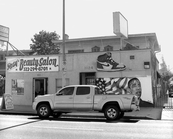 A taco restaurant Berger photographed in 2009 on King Blvd. in South L.A. that had a mural of King standing next to the pope.