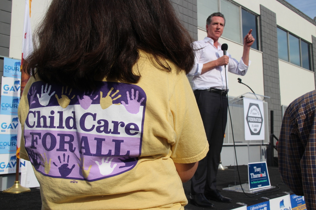 Gavin Newsom pledged his support for child care providers at an rally ahead of the election.