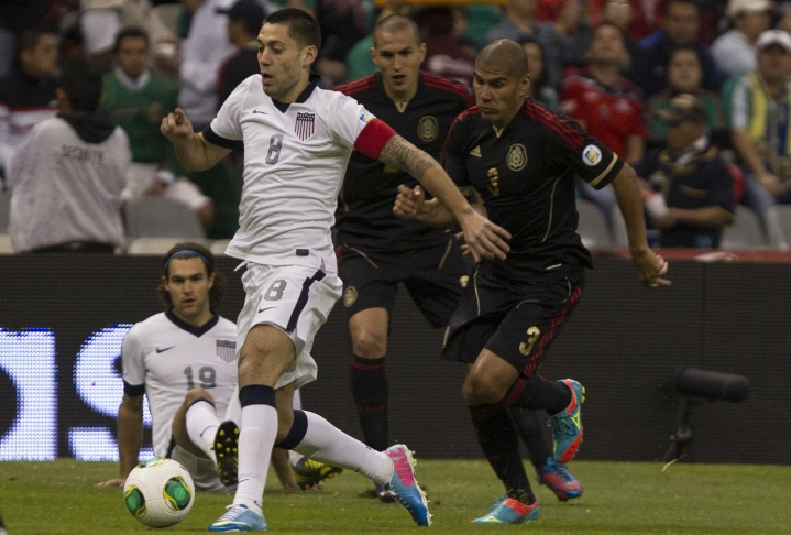 Javier Hernandez, nicknamed Chicharito, of Mexico fights for the ball with Mattew Besler of the United States during a match between Mexico and US as part of FIFA 2014 World Cup Qualifier at The Azteca Stadium on March 26, 2013 in Mexico City, Mexico.