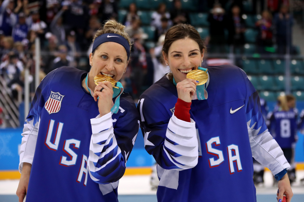 Gold medal winners Meghan Duggan #10 and Hilary Knight #21 of the United States celebrate after defeating Canada in a shootout in the Women's Gold Medal Game at the PyeongChang 2018 Winter Olympics on February 22, 2018.