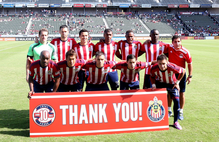 eec00cb9b Chivas USA poses for a pregame tam photo in front of a sign thanking fans  for