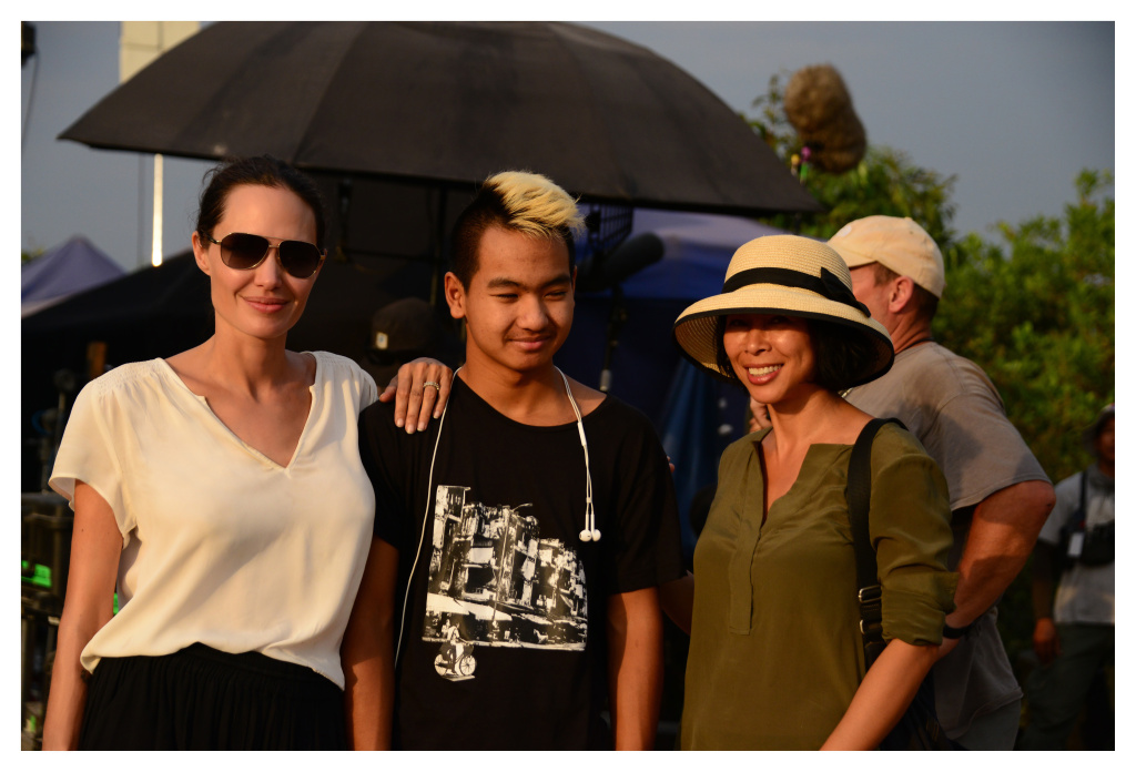 Angelina Jolie and her son Maddox with the Cambodian author Loung Ung, who co-wrote the screenplay for