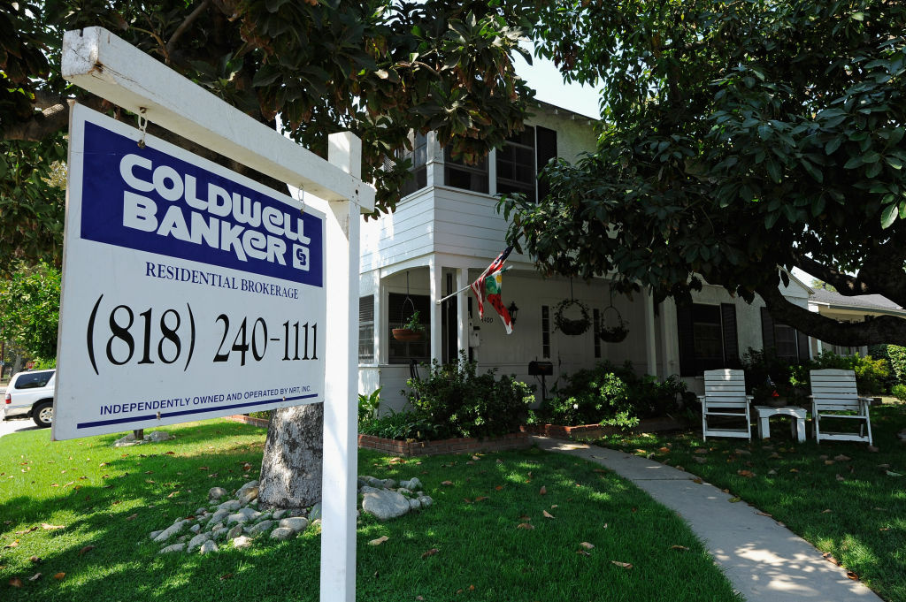 File: A for sale sign is posted in front of house on September 15, 2011 in Glendale, California.