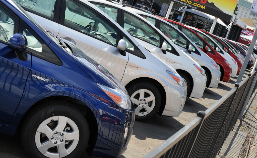 Toyota Prius hybrid model cars wait for customers at a Toyota dealer in Hollywood.