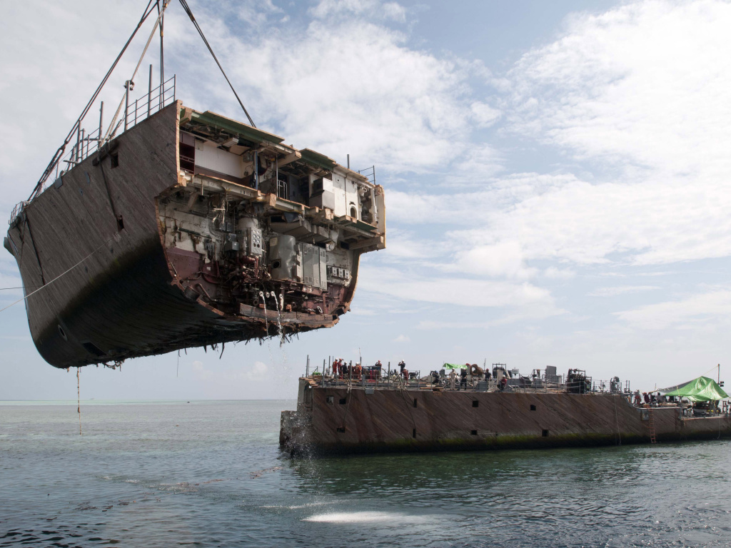 The bow of the mine countermeasure ship Guardian is removed in March in Sulu Sea, Philippines. The Guardian ran aground on the Tubbataha Reef in January.