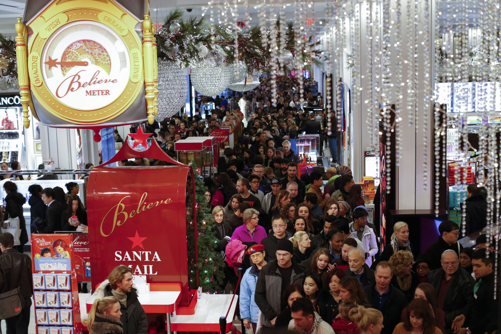Customers stream into Macy's flagship store in Herald Square on Thanksgiving evening for early Black Friday sales on November 26, 2015 in New York City.