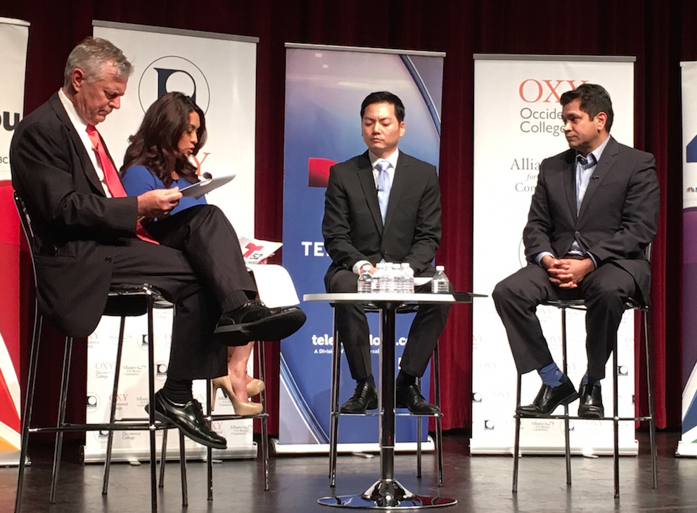 NBC4 commentator Conan Nolan, left, and Telemundo anchor Dunia Elvir moderate a forum featuring the two candidates running in the 34th Congressional District, Robert Ahn, second from right, and Jimmy Gomez, right.