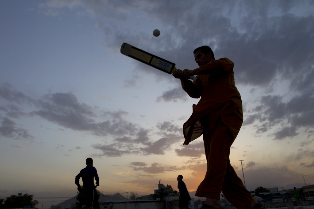 File: An Afghan cricket batsman hits the ball during a local game June 15, 2011 in Kabul, Afghanistan.