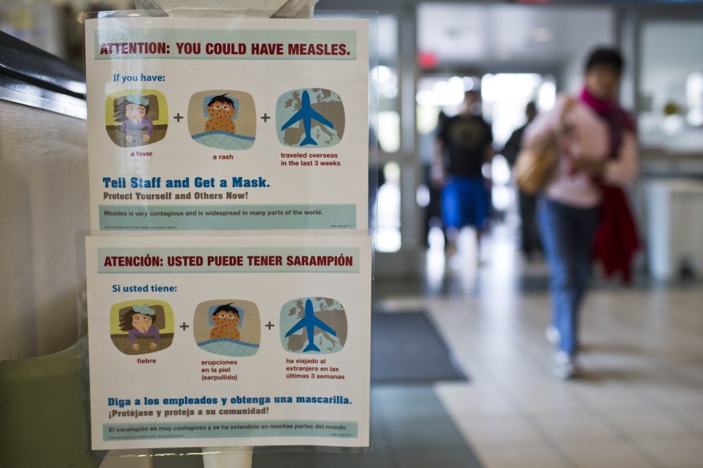 Posters list measles symptoms at the entry points of Olive View UCLA Medical Center in Sylmar on Monday, Jan. 26. The hospital has posted the signs after the recent measles outbreak in Southern California.