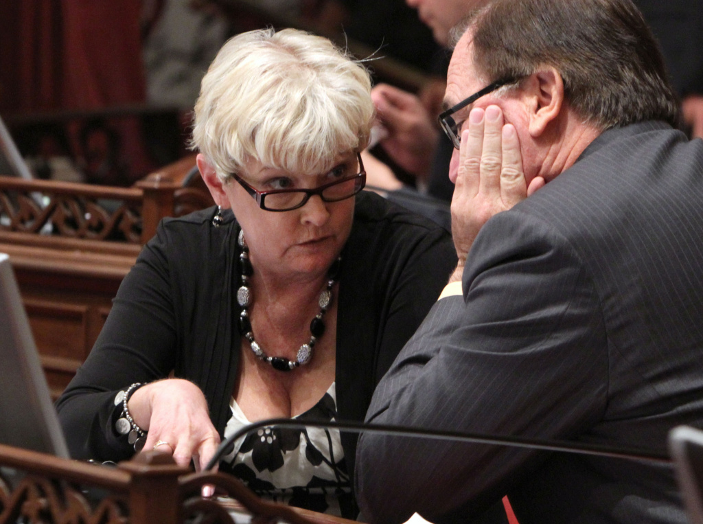 File: Senate Republicans, Sharon Runner, of Lancaster and Bob Huff, of Diamond Bar, confer during the Senate session at the Capitol in Sacramento, Calif., Thursday, Sept. 8, 2011.