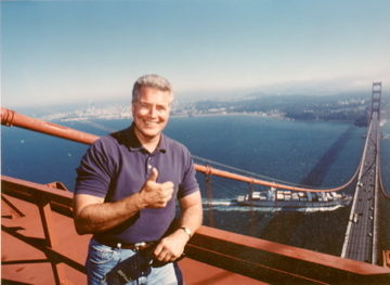 Huell Howser at the top of the Golden Gate Bridge.