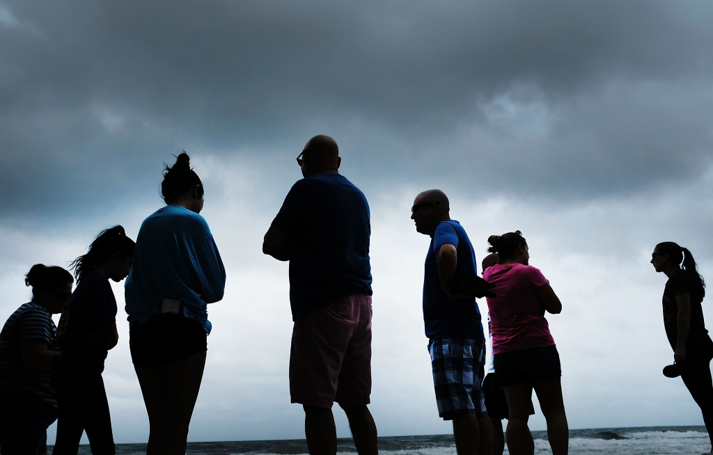 People gather at the beach in Naples, Florida before the arrival of Hurricane Irma on September 9, 2017.