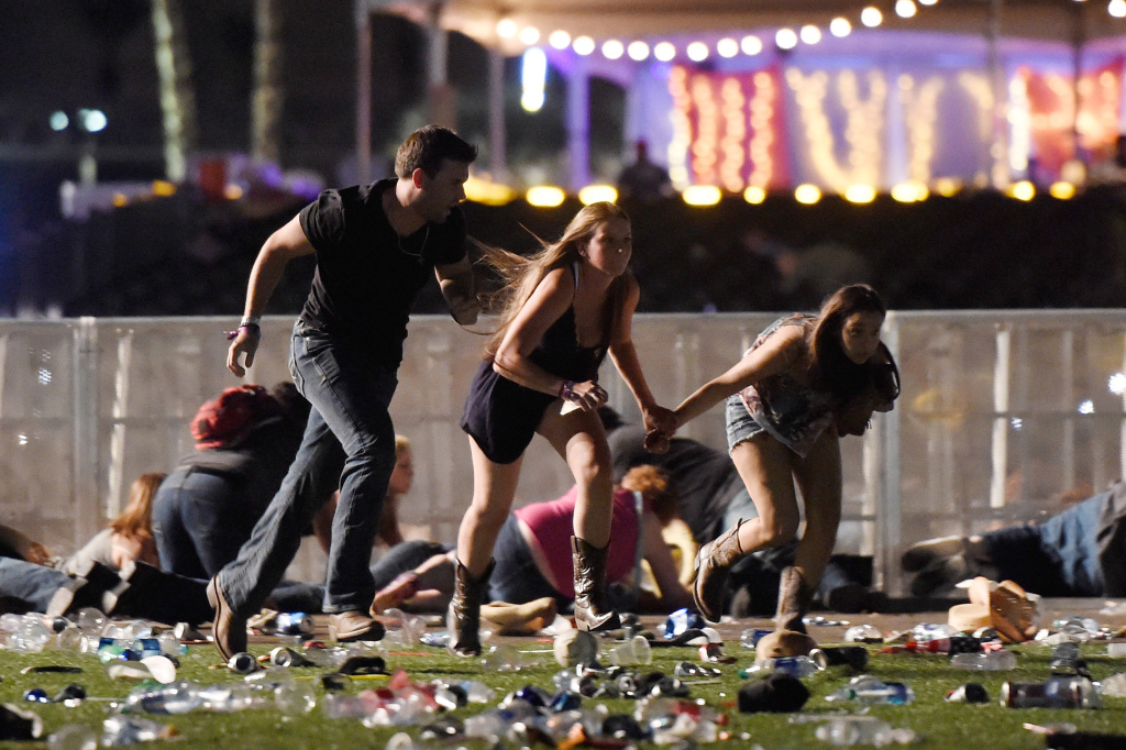 People run from the Route 91 Harvest country music festival after apparent gunfire was heard on Oct. 1, 2017 in Las Vegas, Nevada. A gunman has opened fire on a music festival in Las Vegas.