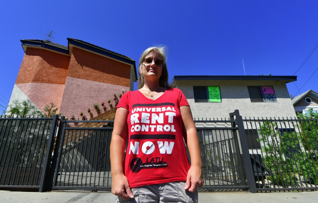 Community activist Elizabeth Blaney stands in front of the apartment block where, with no rent control due to the year it was built, the landlord has increased some rentals by as much as $800, August 3, 2017 in the Boyle Heights neighborhood of Los Angeles, California. Pending gentrification and increasing rent is sparking concern among longtime residents and community aid groups.     / AFP PHOTO / FREDERIC J. BROWN / TO GO WITH AFP STORY by Veronique DUPONT, US-Art-Protest-Minorities-Housing         (Photo credit should read FREDERIC J. BROWN/AFP/Getty Images)