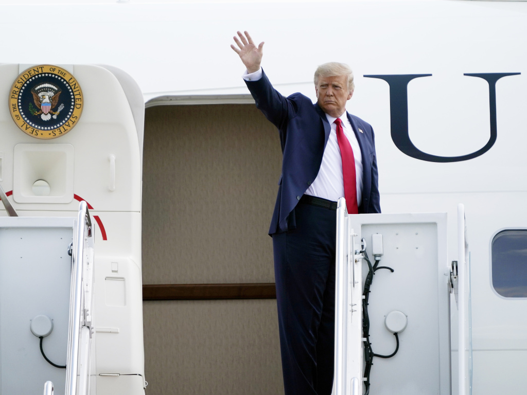 President Trump boards Air Force One on Tuesday at Andrews Air Force Base in Maryland.