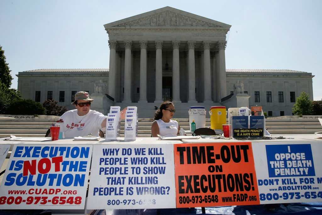 Activists participate during a vigil against death penalty in front of the U.S. Supreme Court July 1, 2008 in Washington, DC. The Abolition Action Committee and the National Coalition to Abolish the Death Penalty held the Vigil to Abolish the Death Penalty to mark the 1972 and 1976 Supreme Court rulings that suspended the death penalty in the United States and later allowed executions to resume.