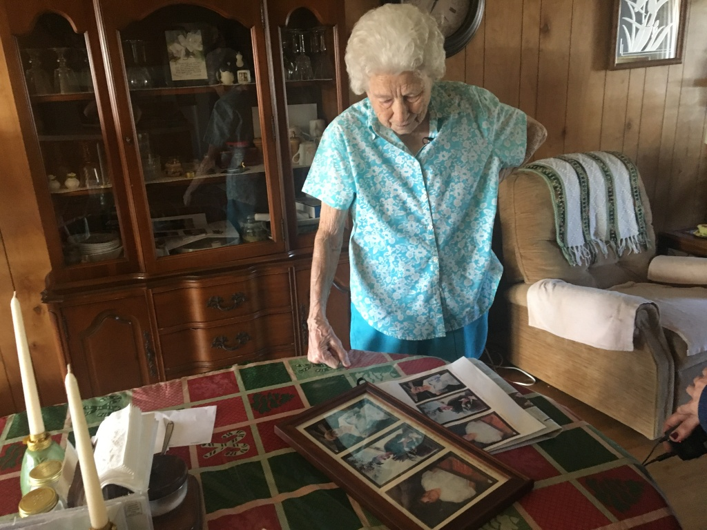 Eleanor Stone, 95, looks at old photos of her three children whom she has outlived, Feb. 8, 2019.