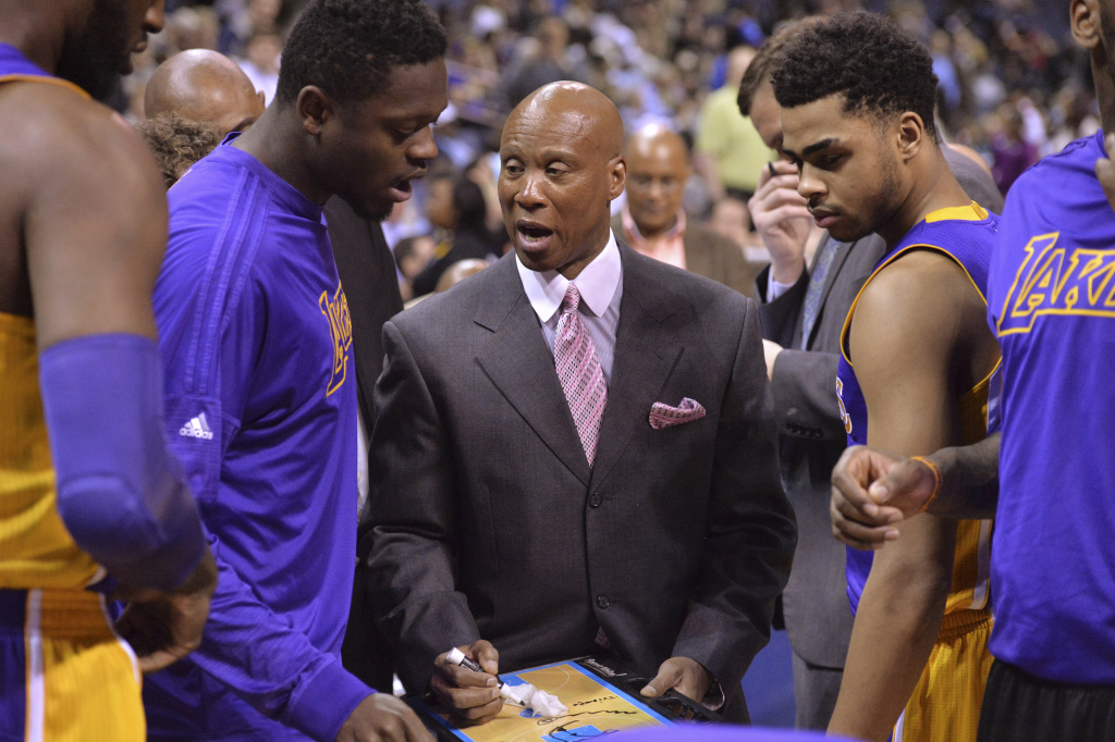 In this file photo, Los Angeles Lakers coach Byron Scott, center, talks with forward Julius Randle, left, and guard D'Angelo Russell, right, during the first half of the team's NBA basketball game against the Memphis Grizzlies on Wednesday, Feb. 24, 2016, in Memphis, Tenn. The Lakers are making another break from the Kobe Bryant era by firing Scott, who shepherded the superstar guard's farewell season, but couldn't coax many wins out of an otherwise dismal roster.