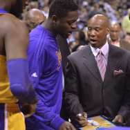 Los Angeles Lakers coach Byron Scott, center, talks with forward Julius Randle, left, and guard D'Angelo Russell, right, during the first half of the team's NBA basketball game against the Memphis Grizzlies on Wednesday, Feb. 24, 2016, in Memphis, Tenn. (AP Photo/Brandon Dill)