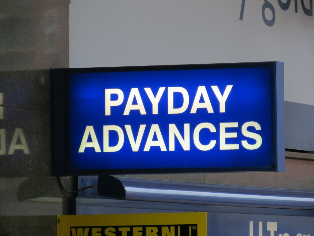 Payday loan business sign .