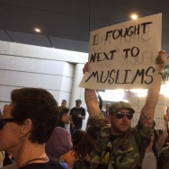 Protesters gathered at LAX on Sunday at Bradley International Terminal to protest President Trump's executive order temporarily banning migrants from 7 Muslim-majority countries.