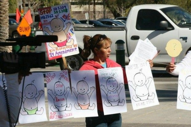 A protestor outside the Arizona state Capitol in Phoenix yesterday, February 7, 2011