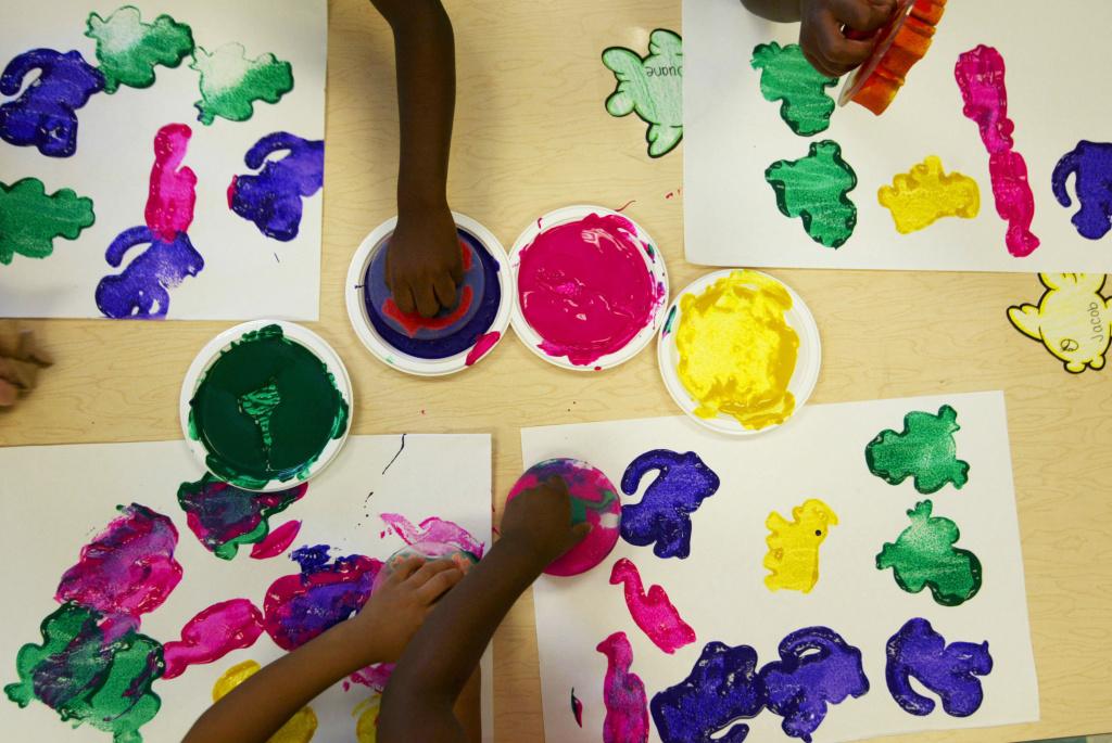 Children finger paint.