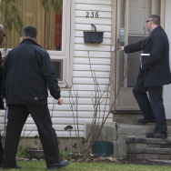 "Royal Canadian Mounted Police investigators canvas the London, Ontario, neighborhood around the home of Stephen Solis-Reyes, who has been charged in connection with exploiting the ""Heartbleed"" bug."