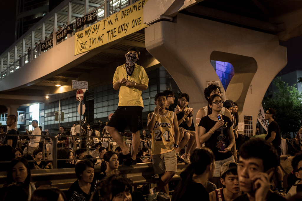 Protesters listen to speeches outside the Hong Kong Government Complex on October 1, 2014 in Hong Kong, Hong Kong. Thousands of pro democracy supporters continue to occupy the streets surrounding Hong Kong's Financial district. Protest leaders have set an October 1st deadline for their demands to be met and are calling  for open elections and the resignation of Hong Kong's Chief Executive Leung Chun-ying.
