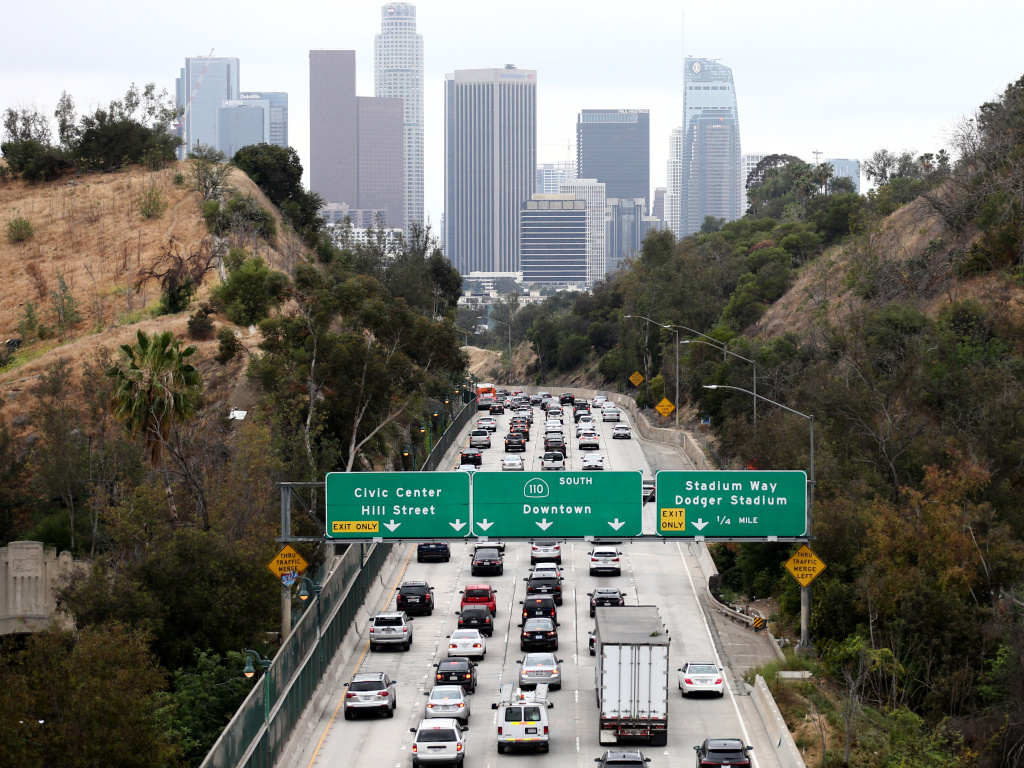 Cars make their way toward downtown Los Angeles on April 22. California could regain the right to set its own vehicle emissions standards after the Environmental Protection Agency announced it was moving to curb a Trump-era policy that sought to erode the state's previously-held power.