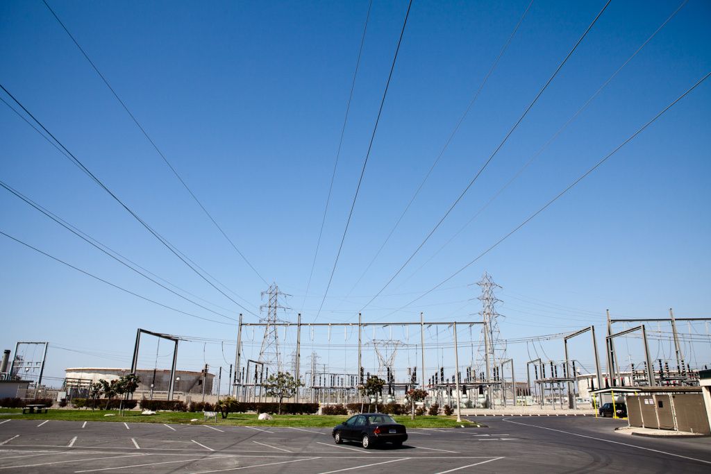 The main transmission lines pass over a parking lot at the AES power plant in Huntington Beach, CA.