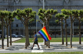 A man carries a gay pride flag through Civic Center Plaza following a California Supreme Court decision to overturn the ban on same-sex marriage at the California Supreme Court May 15, 2008 in San Francisco, California
