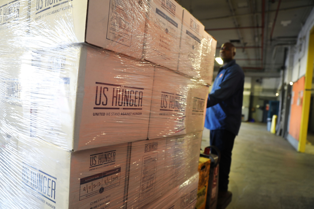 A worker for the Food Bank For New York City moves a pallet of food headed to hurricane-ravaged Puerto Rico on September 29, 2017.