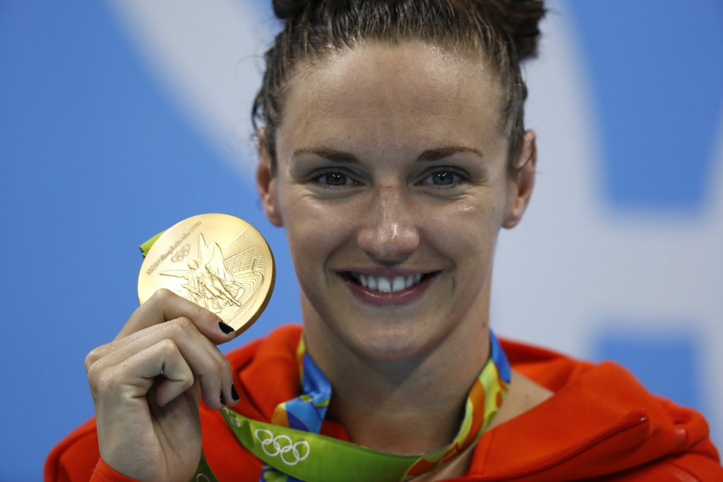 Hungary's Katinka Hosszu poses with her gold medal on the podium after she won the Women's 200m Individual Medley Final during the swimming event at the Rio 2016 Olympic Games at the Olympic Aquatics Stadium in Rio de Janeiro on August 9, 2016.