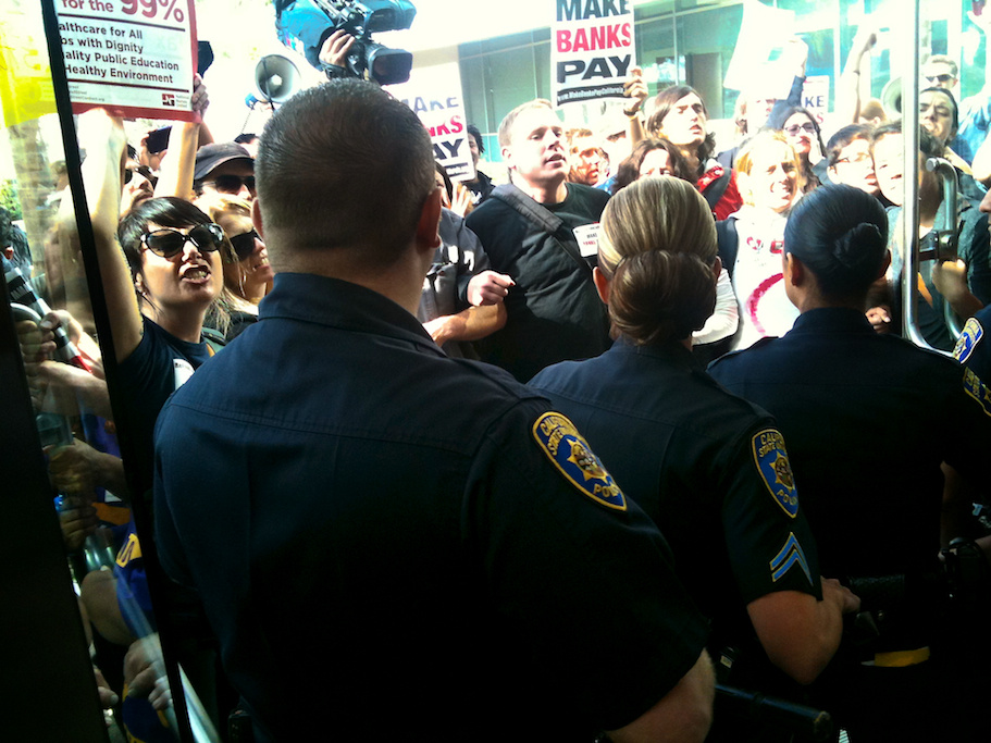 Police face protesters at CSU Board of Trustees meeting, Nov. 16, 2011