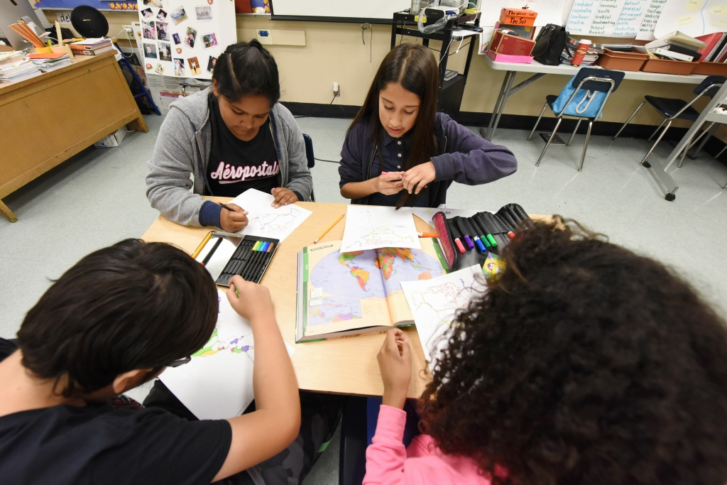 Students work on a project identifying countries in North, Central and South America during a history class taught in Spanish as part of the Dual Language Academy program Franklin High School in Los Angeles, California, on May 25, 2017.