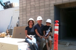 A Noise Within Founders/Artistic Directors Geoff Elliott and Julia Rodriguez-Elliott, and son, at the site of the new 33,000 square-foot state-of-the-art venue in Pasadena, which opens October 29. The theatre company made its home in Glendale for 19 years.
