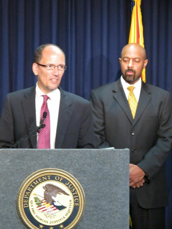 Assistant Attorney General for Civil Rights Thomas E. Perez with Deputy Assistant Attorney General Roy Austin in Phoenix on Thursday.